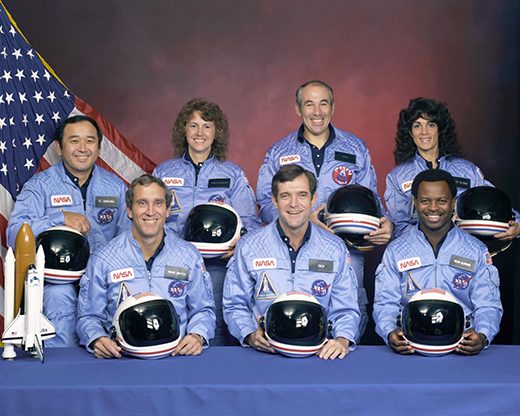 Crew portrait of the Challenger astronauts who died when the shuttle exploded during launch on Jan. 28, 1986. Back row L-R: Ellison Onizuka, Christa McAuliffe, Greg Jarvis, and Judy Resnik. Front Row: Mike Smith, Dick Scobee, and Ron McNair.